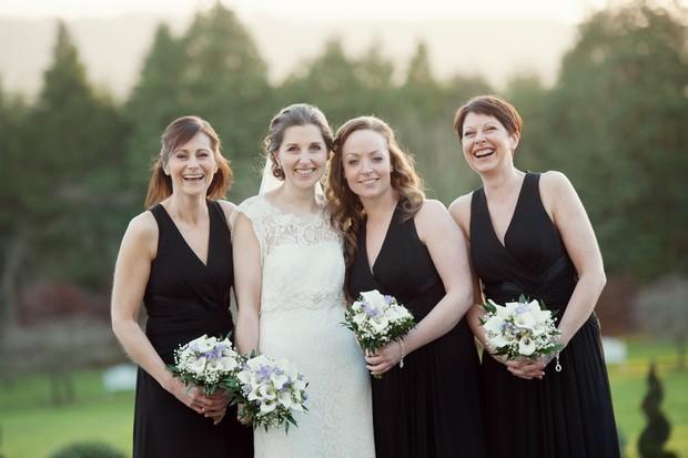 bridesmaids in black dresses winter wedding