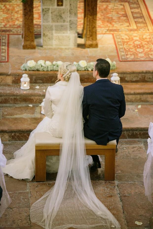 bride groom meet at altar at church wedding