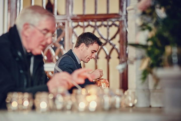 17-groomsmen-lighting-candles-wedding-church