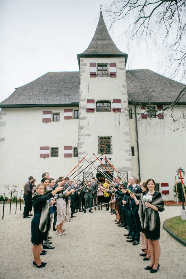 winter wedding guard of honour with skis