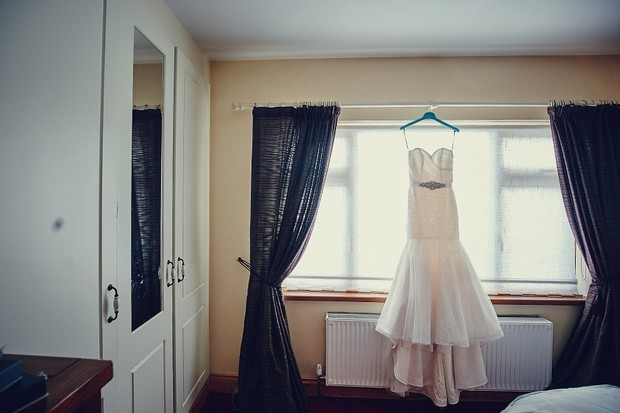 2-mermaid-wedding-dress-hanging-room