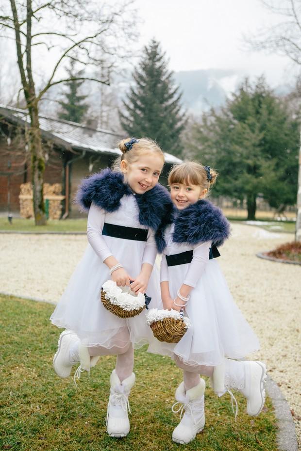 duck egg blue winter wedding flower girls in faux fur