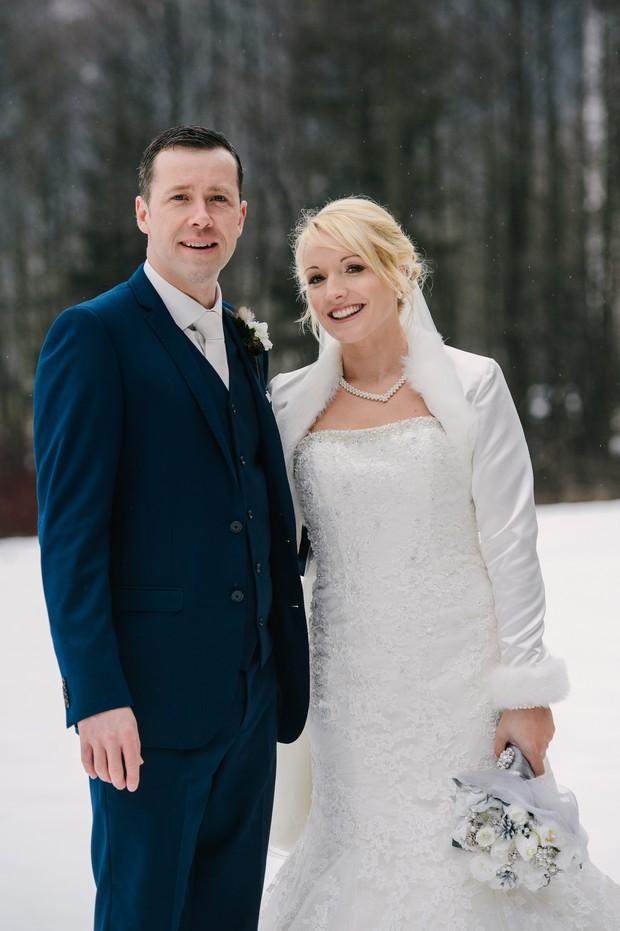 bride groom in snow winter wedding