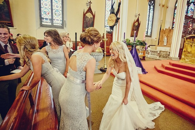 34-bridesmaids-bride-greeting-church-wedding