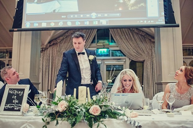 65-bride-watching-wedding-video-laptop