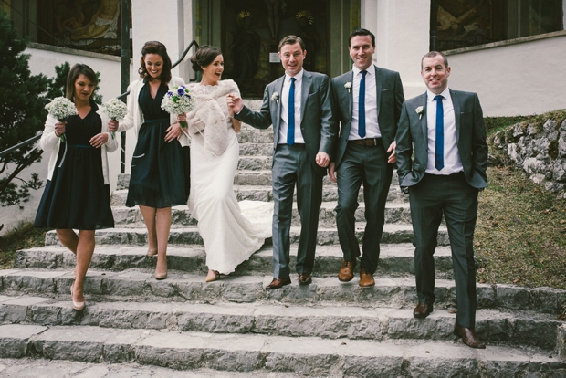 bridal-party-bridesmaids-in-green-dresses-groomsmen-in-grey-suits