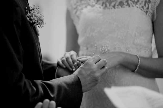bride-and-groom-exchanging-rings-at-church-wedding-ceremony-germany