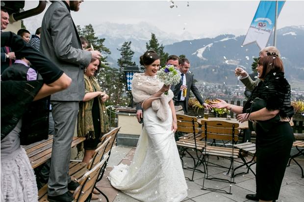 bride-in-faux-fur-shrug-confetti-toss