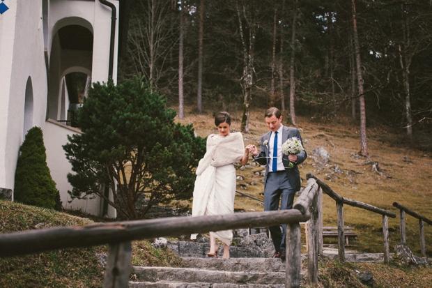 bride-in-faux-fur-stole-groom-in-grey-suit