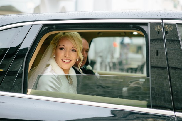 winter bride in wedding car in snow