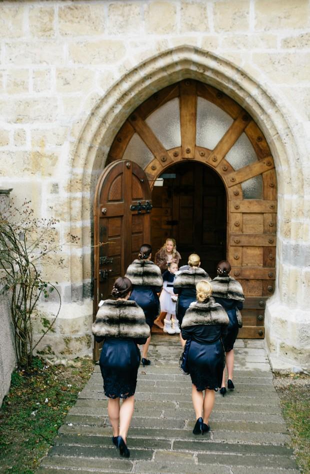 bridesmaids in faux fur stoles in snow