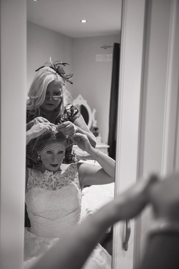 charlene-stephen-wedding-bride-fixing-birdcage-veil