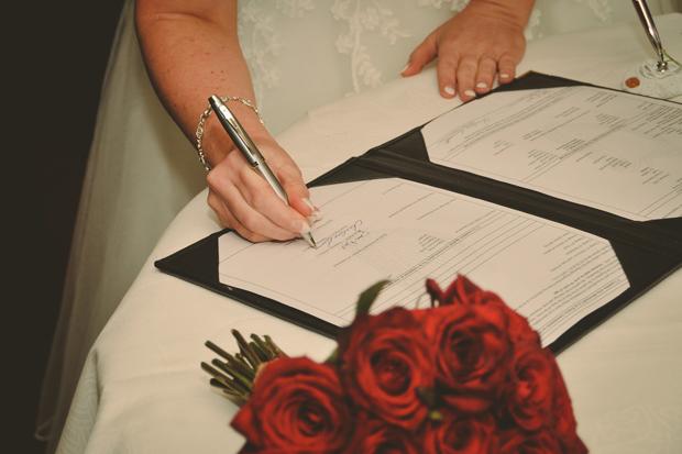 charlene-stephen-wedding-bride-signing-register