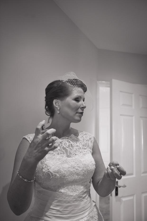 charlene-stephen-wedding-bride-spraying-perfume