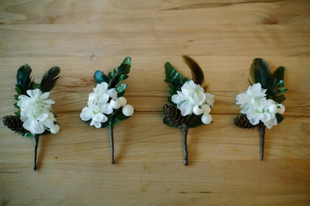 snow berry winter wedding boutonniere button holes