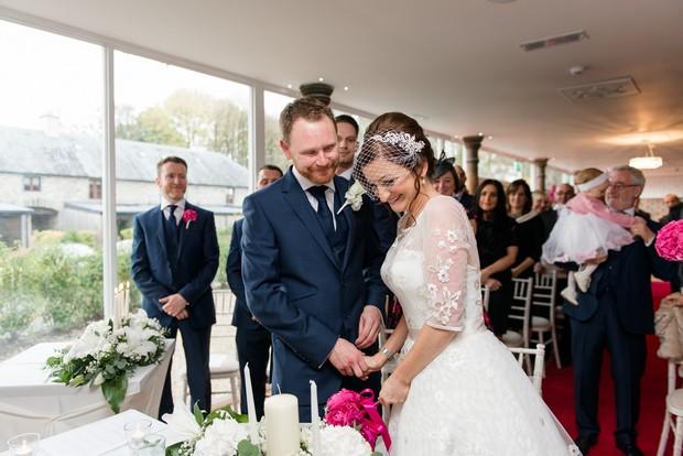 15-bride-laughing-during-wedding-vows