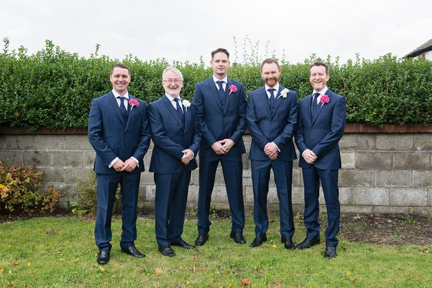 5-groomsmen-navy-suits-pink-boutonnieres
