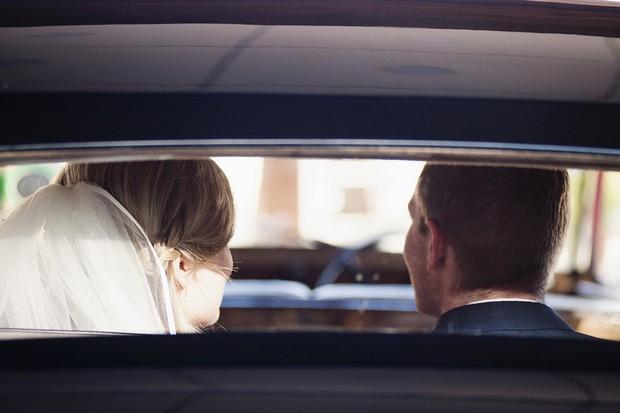 bride-and-groom-leaving-wedding-ceremony-car