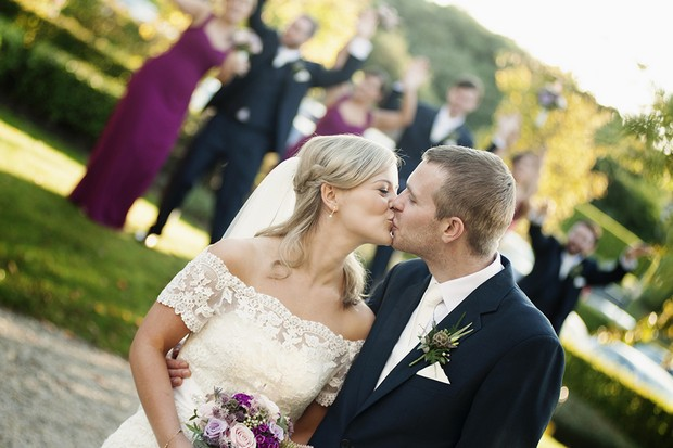 bride-groom-kissing-druids-glen-resort-real-wedding