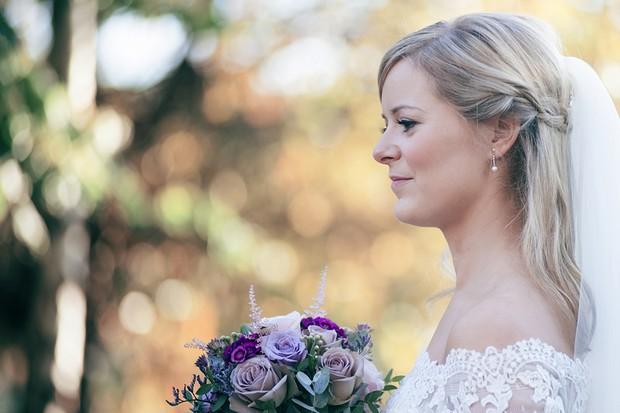 bride-with-pink-purple-bridal-bouquet