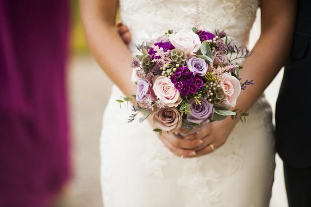 bride-with-purple-pink-bouquet