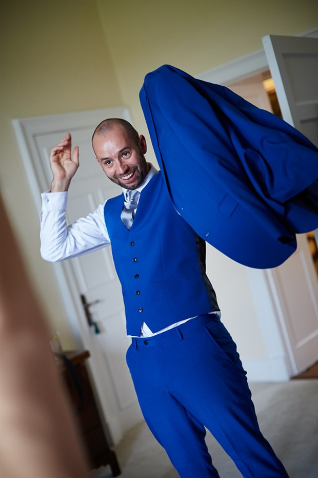 Groom in stylish electric blue wedding suit