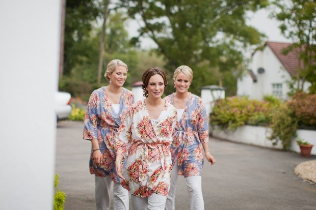 7_bridesmaids_in_floral_print_robes_street