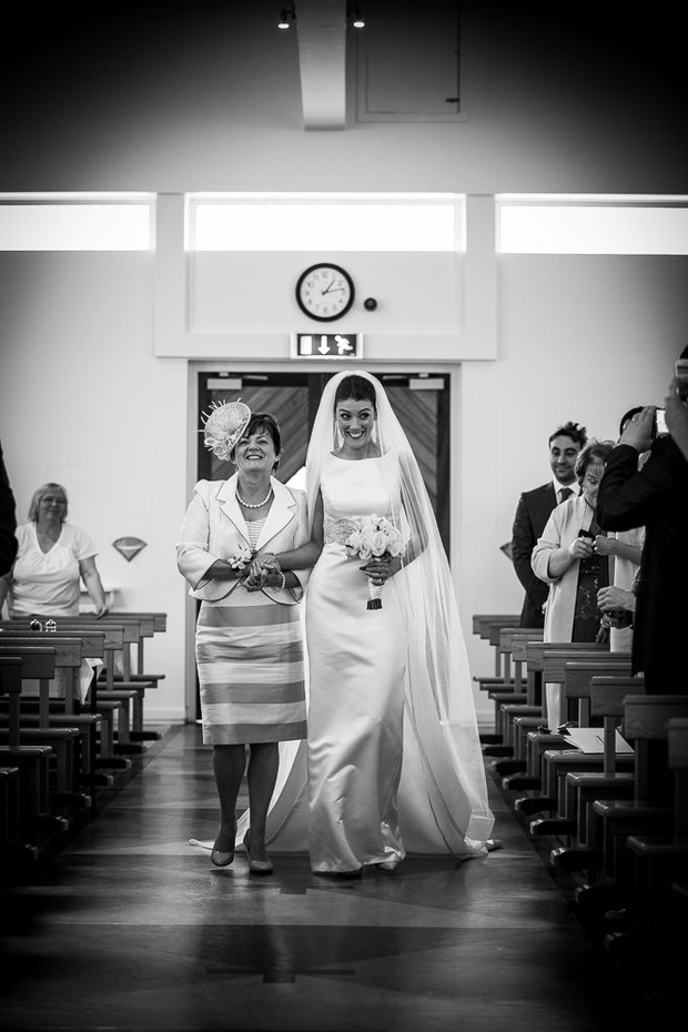 bride mother walking up aisle