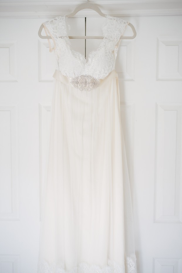 Claire Pettibone Lace Wedding Dress on Hanger