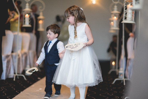 23-flower-girl-page-boy-walking-aisle-holding-hands