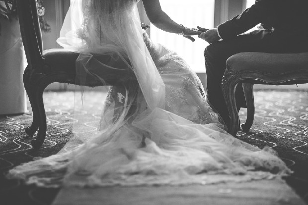 28-fine-art-black-white-wedding-photography-ceremony-holding-hands