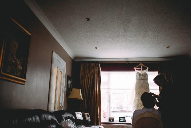 3-fine-art-wedding-photography-bride-getting-hair-done