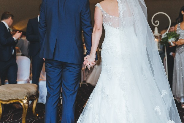 31-bride-groom-close-up-hand-holding-walking-down-aisle