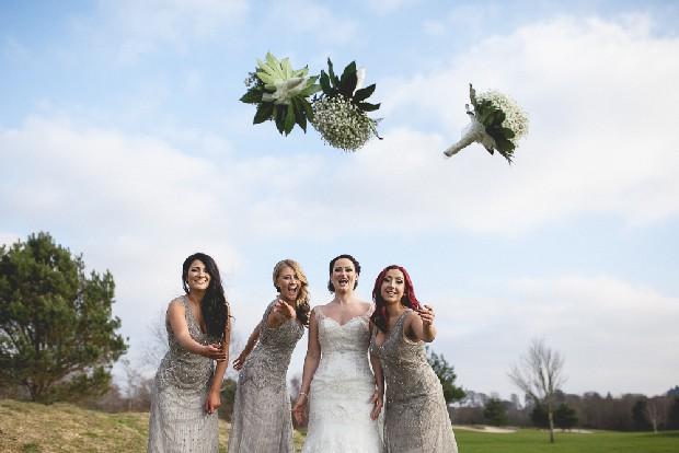 34-bride-bridesmaids-throwing-bouquet-outdoors