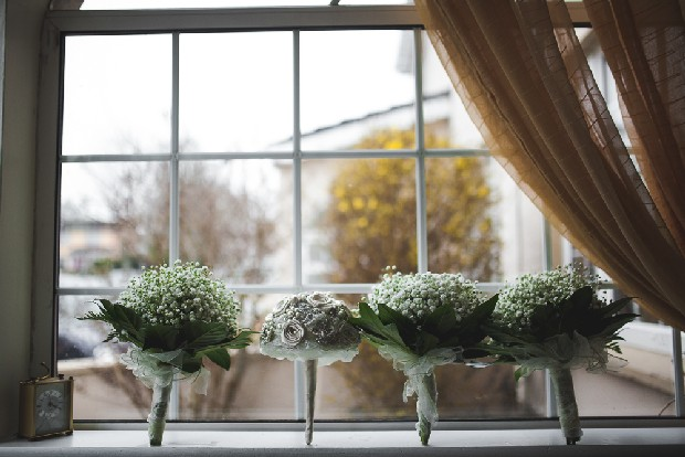 7-photo-of-bridesmaids-bouquet-babys-breath-on-window