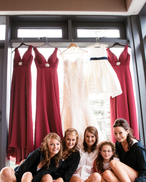 bride-bridesmaids-with-hanging-dresses