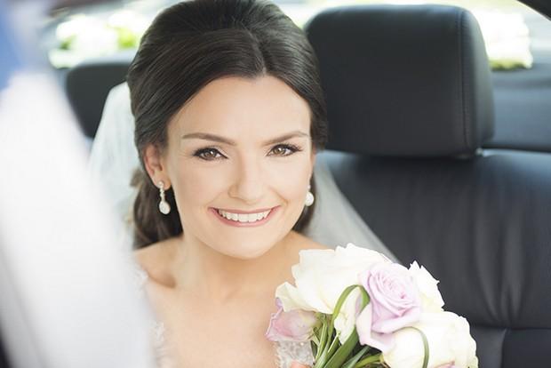 pretty-bride-in-wedding-car