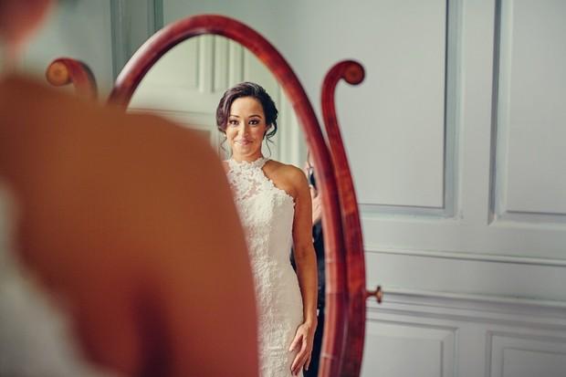 10-happy-bride-looking-in-mirror