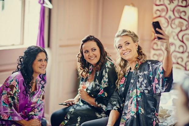 4-bridesmaids-taking-selfie-morning
