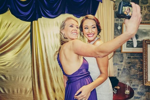 bride-bridesmaids-taking-selfies