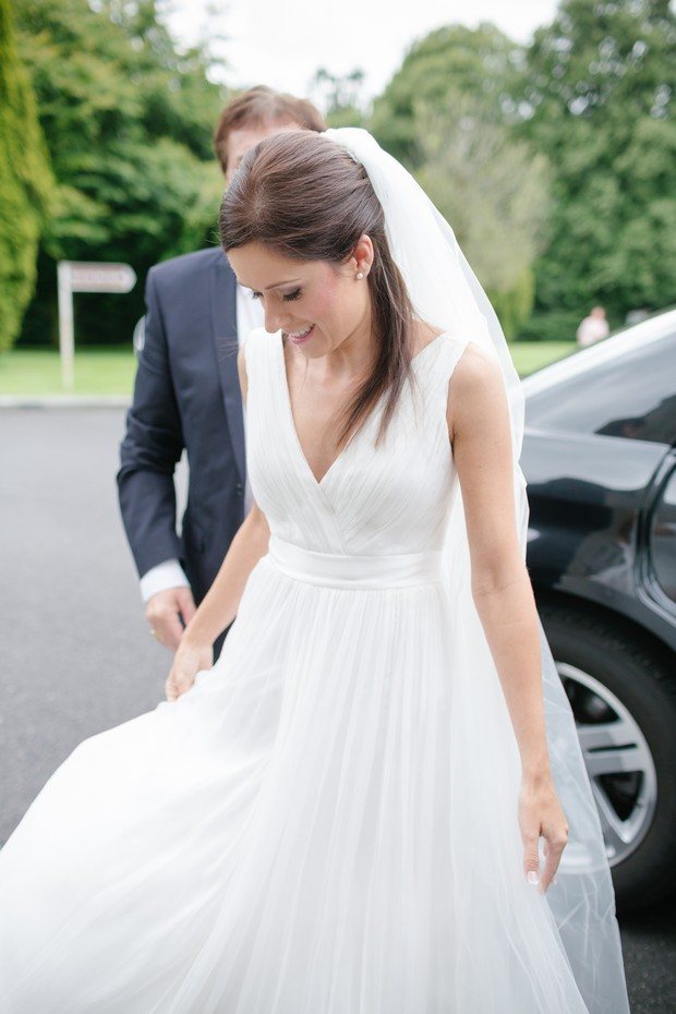 bride-getting-out-of-wedding-car