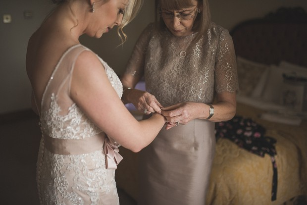 Bride Getting Ready With Mother Morning Of Wedding