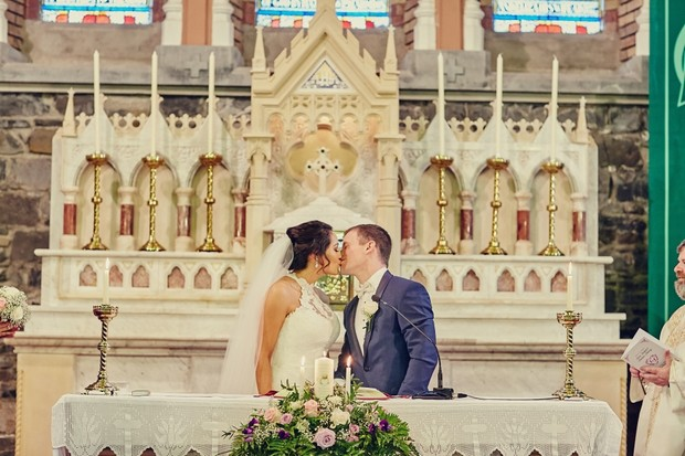 bride-groom-kiss-altar-wedding-ceremony