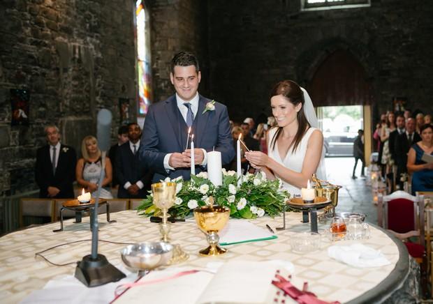 bride-groom-lighting-wedding-candles