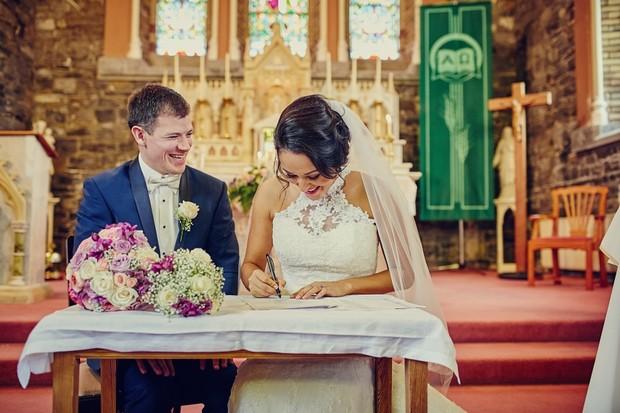 bride-groom-signing-registry