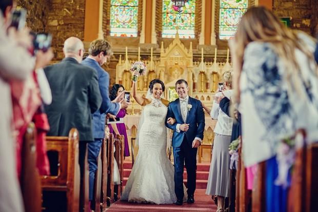 bride-groom-walking-aisle-cheering