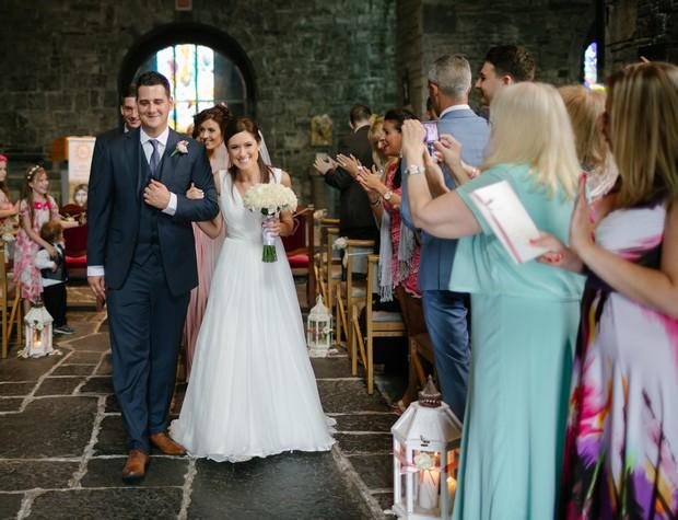 bride-groom-walking-down-aisle-together