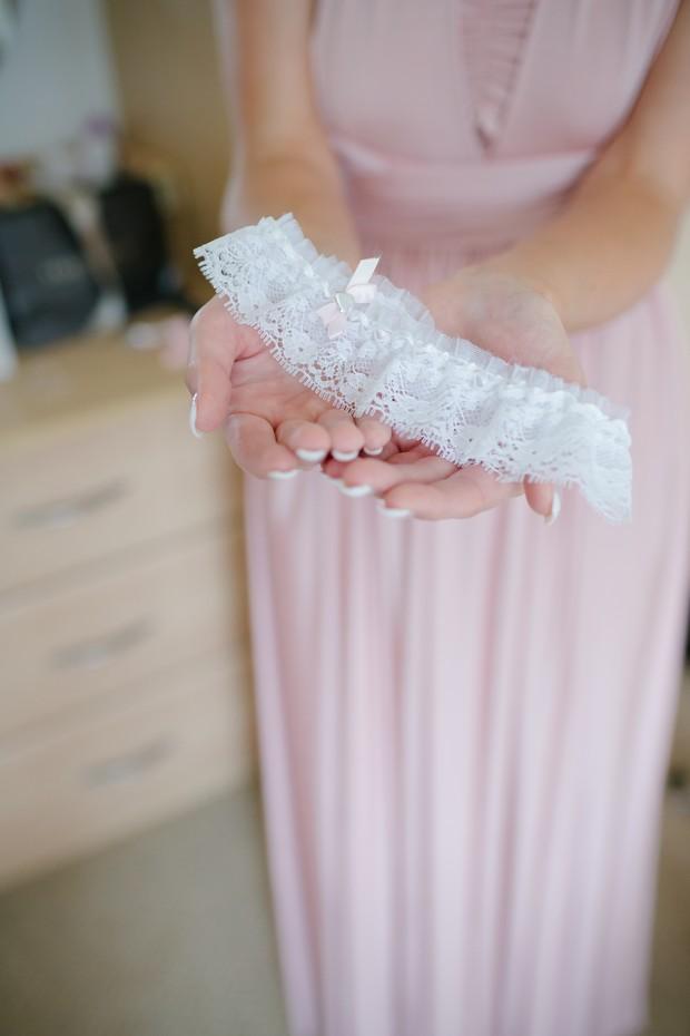 bridesmaid-holding-white-lace-garter