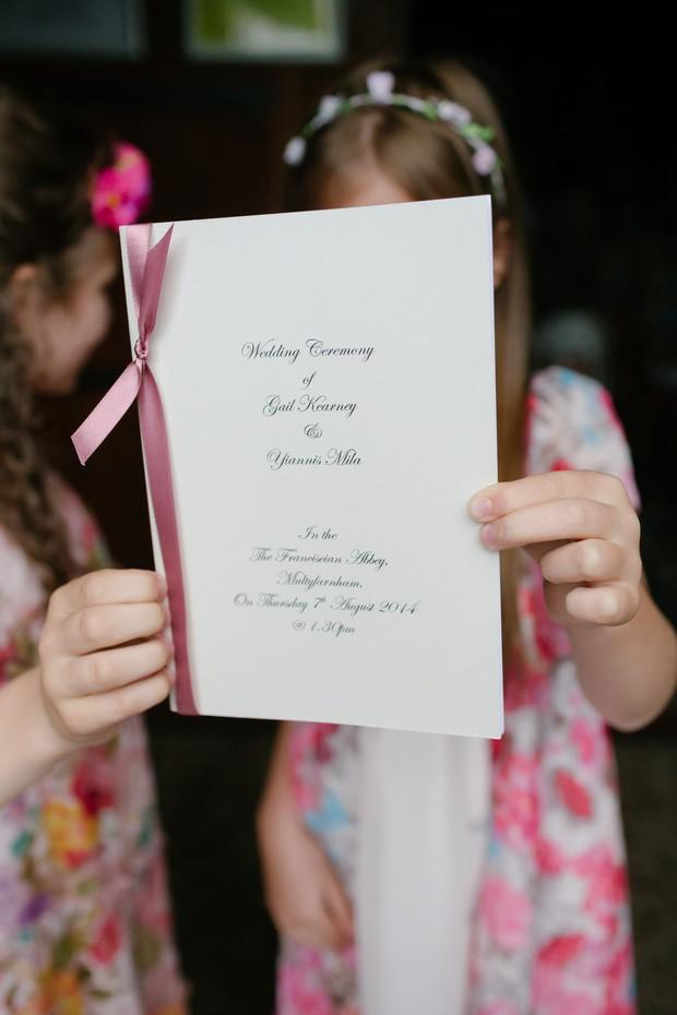 flower-girls-holding-up-wedding-mass-booklet