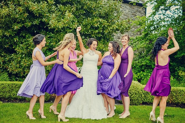 fun-bridesmaids-purple-dancing-mis-matched